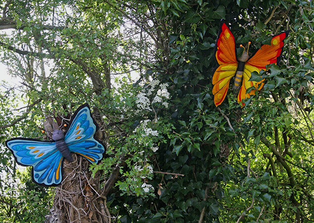 Hand made butterflies placed in a tree