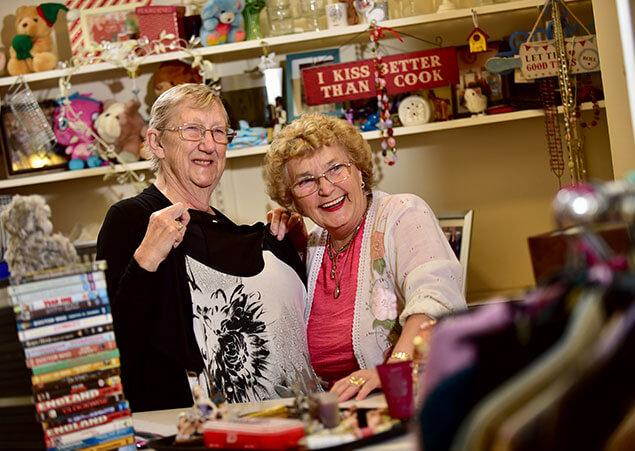 Women clothes shopping having fun